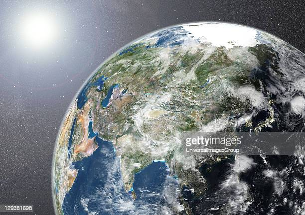 True colour satellite image of the Earth showing Asia half in shadow with cloud coverage and the sun This image in orthographic projection was...