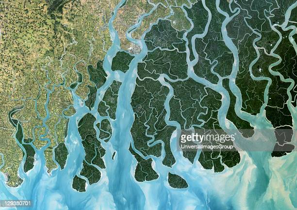 True colour satellite image of the Ganges River that forms an extensive delta where it empties into the Bay of Bengal The delta is largely covered...