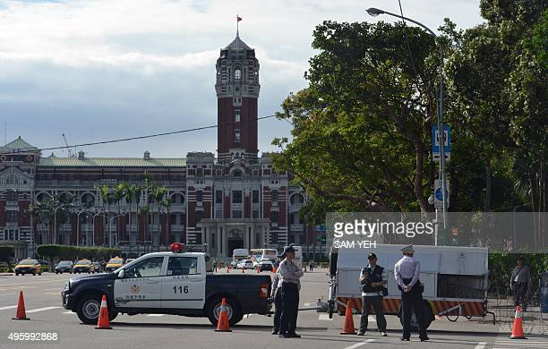 True colours: China summit foments Taiwan's green-blue split by Benjamin YEH Police stand guard in front of the Presidential Palace in Taipei on...