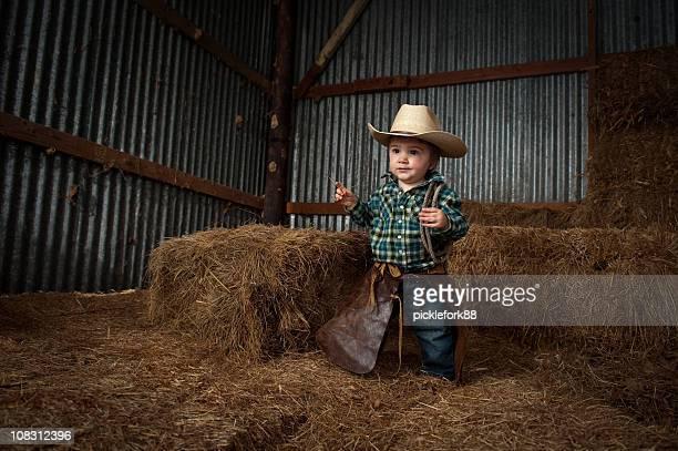 本物のカウボーイの赤ちゃん - 乗馬ズボン ストックフォトと画像