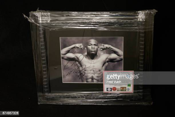 Portrait of signed photograph of boxer Floyd Mayweather Jr with certificate of authenticity during photo shoot at Canfield Police Department Canfield...