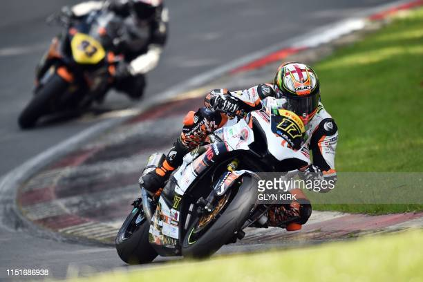 True Heroes racing Team rider Jim Walker during practice for the Pirelli National Superstock 1000 bike race, part of the Bennetts British Superbike...
