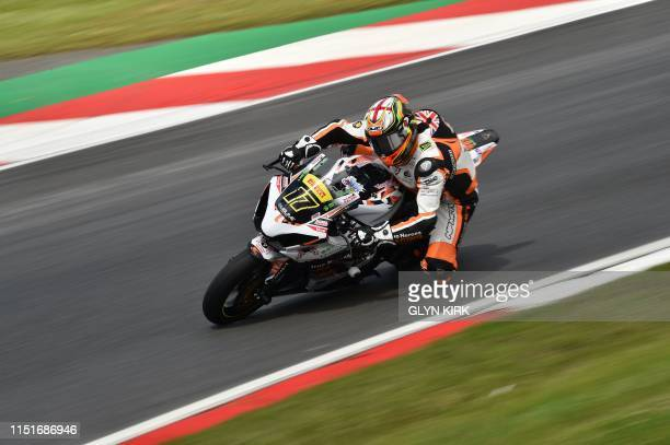 True Heroes racing Team rider Jim Walker during practice for the Pirelli National Superstock 1000 bike race part of the Bennetts British Superbike...