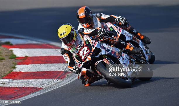 True Heroes racing Team riders Dave MacKay and Dave Sellers during practice for the Ducati Performance TriOptions Cup bike race, part of the Bennetts...