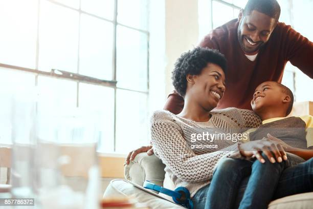 true joy when we chilling with our boy - happy family stock photos and pictures