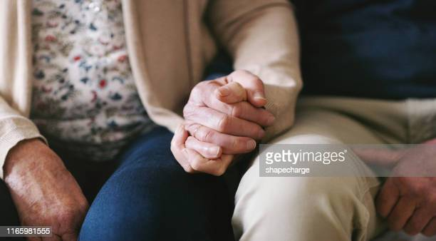 true love is enduring - holding hands stock pictures, royalty-free photos & images