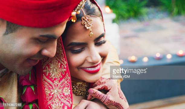 true love will keep you safe - indian wedding stock pictures, royalty-free photos & images