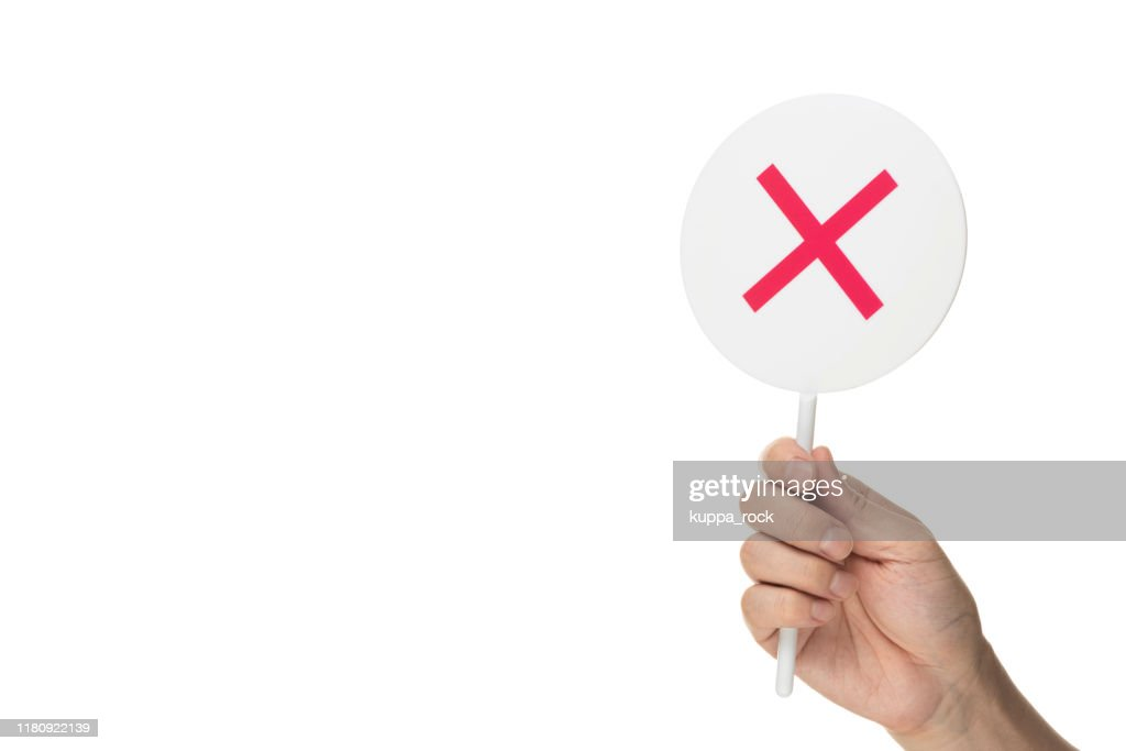 "True or False Game. Men hold in hand ""False"" : Stock Photo"