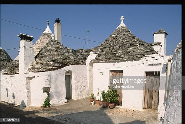 A trulli house a whitewashed stone house with conical roof made without mortar Alberobello Puglia Italy