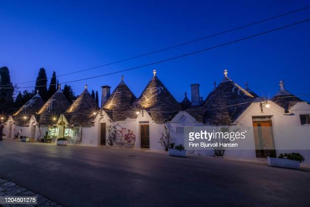 trulli houses at night in alberobello in puglia italy - finn bjurvoll stock pictures, royalty-free photos & images