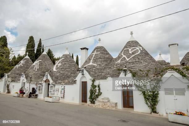 trulli houses in alberobello, italy - alberobello stock pictures, royalty-free photos & images