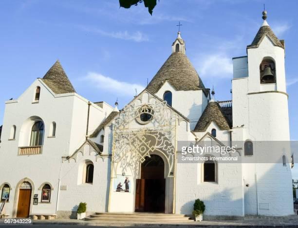 'Trullo church' facade in Alberobello, Italy