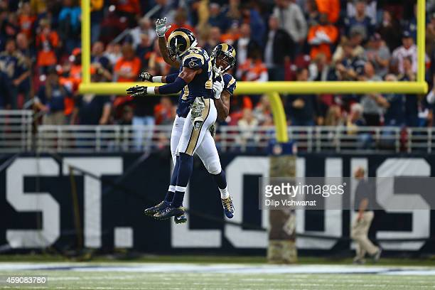 Trumaine Johnson of the St Louis Rams and TJ McDonald of the St Louis Rams celebrate after a turnover in the fourth quarter against the Denver...