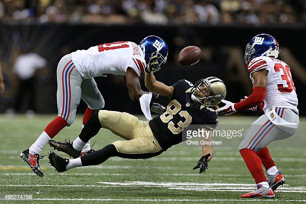 Trumaine McBride of the New York Giants catches a loose ball lost by Willie Snead of the New Orleans Saints during the fourth quarter of a game at...