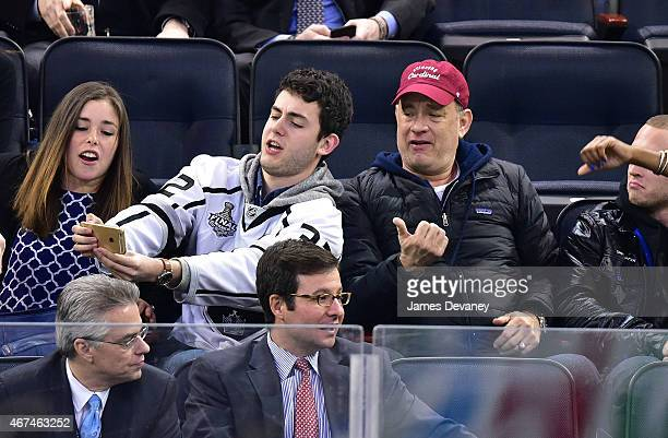 Truman Hanks and Tom Hanks attend the Los Angeles Kings vs New York Rangers game at Madison Square Garden on March 24 2015 in New York City