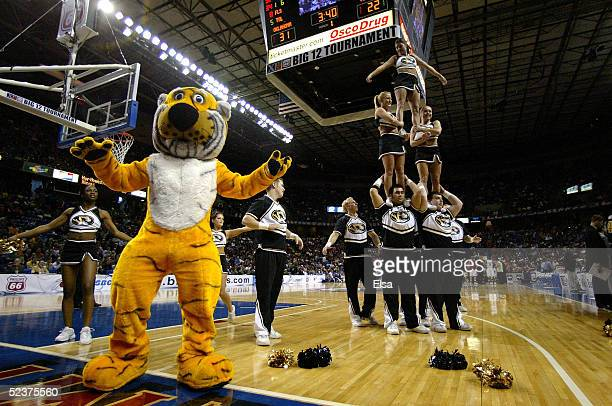 Truman, the mascot of the Missouri Tigers, along with the cheerleaders perform for the crowd during a break in the game against the Oklahoma Sooners...