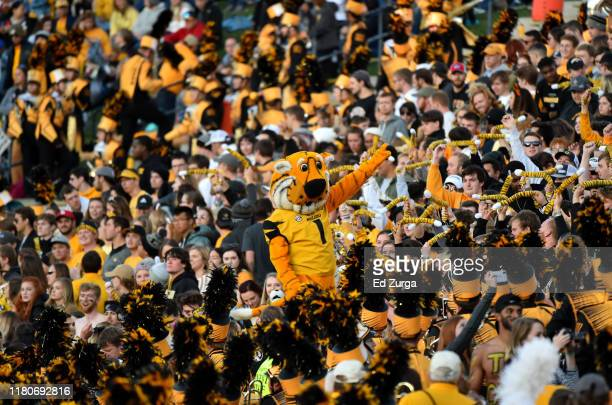 Truman the Tiger the Missouri Tigers mascot leads fans as they cheer on their team against the Mississippi Rebels in the first quarter at Faurot...