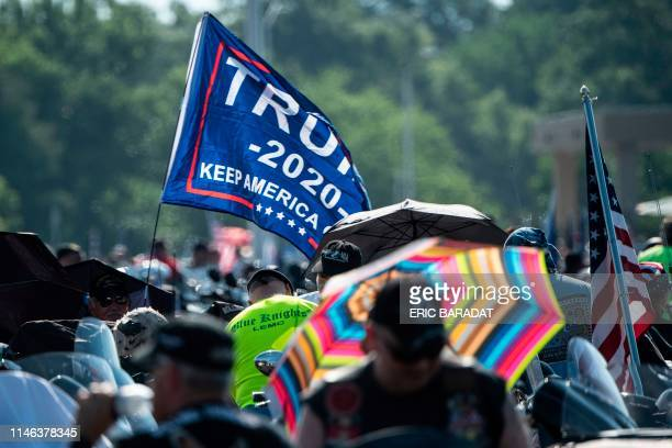 A Trump 2020 flag is seen as hundreds of thousands of bikers gather on the Pentagon Parking before taking part in the Rolling thunder parade part of...