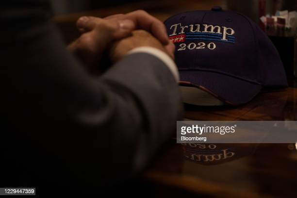 A Trump 2020 hat during a 2020 US presidential election night 'Trump Re Election' watch party at Huron Valley Guns in New Hudson Michigan US on...