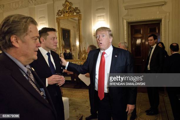 Trump advisor Steve Bannon watches as US President Donald Trump greets Elon Musk SpaceX and Tesla CEO before a policy and strategy forum with...