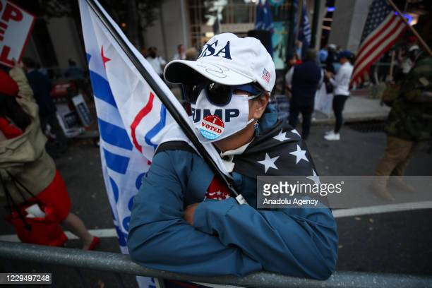 Trump and Biden supporters gather at the Convention Center as Biden supporters early celebrate in Philadelphia, Pennsylvania on November 6, 2020.