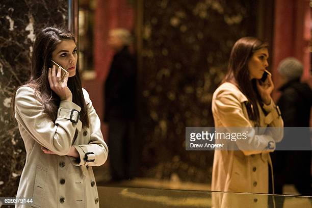 Trump campaign communications director Hope Hicks talks on her phone in the lobby at Trump Tower December 12 2016 in New York City Presidentelect...