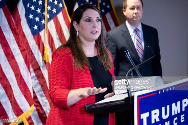 Trump Campaign general council Matthew Morgan listens while Chairman of the Republican National Committee Ronna McDaniel speaks during a press...