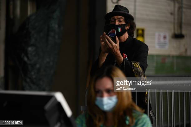 Trump campaign poll watcher films the counting of ballots at the Allegheny County elections warehouse on November 6, 2020 in Pittsburgh,...