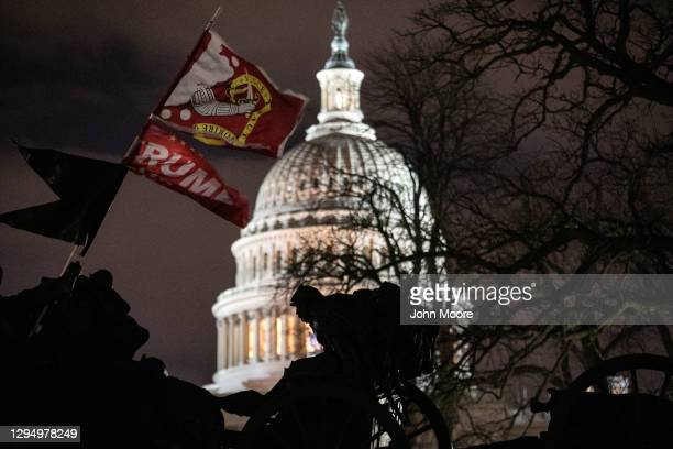 Trump flag flies over the grounds of the U.S. Capitol on January 06, 2021 in Washington, DC. A pro-Trump mob stormed the Capitol earlier, breaking...