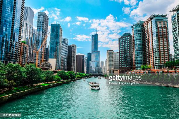 trump international hotel & tower - chicago by chicago river against sky - chicago stock pictures, royalty-free photos & images