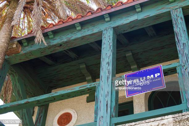 a trump, make america great again sign outside in a balcony at st augustine, florida, usa - donald trump us president stock pictures, royalty-free photos & images