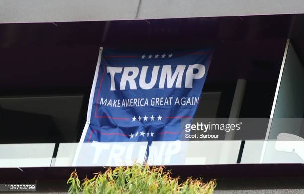 Make America Great sign hangs from a window in a building above the Stand Against Racism and Islamophobia Fraser Anning Resign rally on March 19 2019...