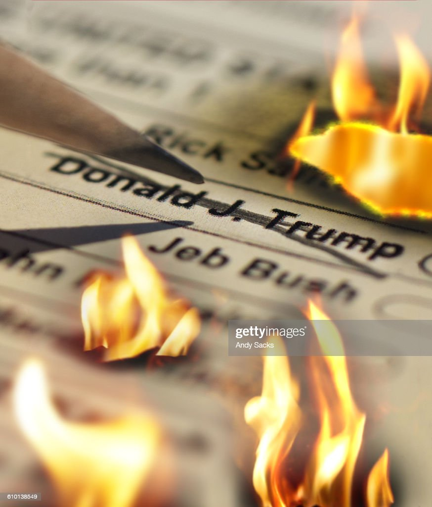 Trump name on ballot up in flames : Stock Photo