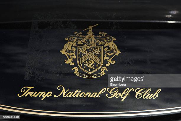 Trump National Golf Club Westchester signage is displayed on a golf cart before Donald Trump presumptive Republican presidential nominee speaks...