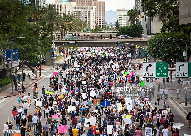 trump protest march, figueroa street downtown los angeles - los angeles protest stock pictures, royalty-free photos & images