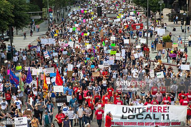trump protest march, figueroa street downtown los angeles - labor union stock photos and pictures