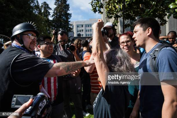 Trump Supporter and a protester argue as a woman attempts to come between the two during a proDonald Trump rally at Martin Luther King Jr Civic...