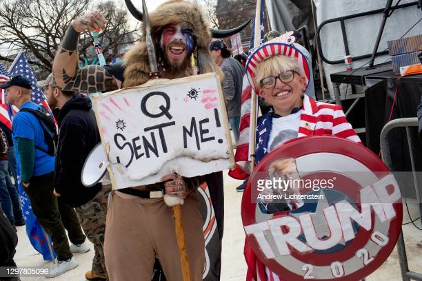 "Trump supporter and QAnon follower Jake ""The Q Shaman"" Angeli attends to the ""Stop the Steal"" rally on December 12, 2020 in Washington, D.C."