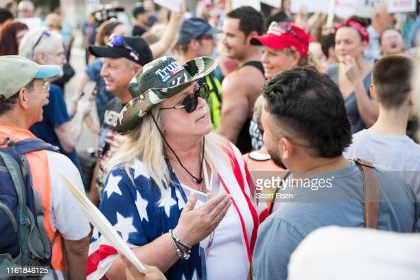 Trump supporter argues with a antiTrump protester outside of a MAGA Campaign rally on August 15 2019 in Manchester New Hampshire