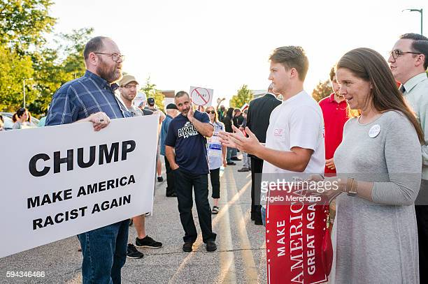 Trump supporter confronts a protestor outside of a rally for Republican Presidential candidate Donald Trump at the James A Rhodes Arena on August 22...