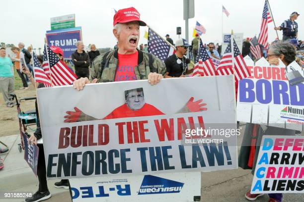 Trump supporter Dan Russell displays a proTrump sign during a proTrump rally attended by about 500 people in San Diego California March 13 where...