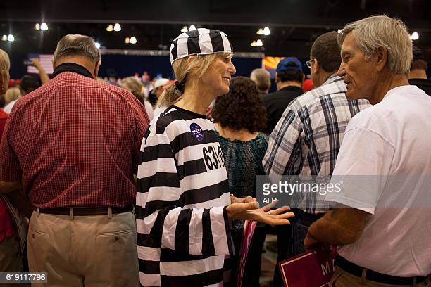 Trump supporter Dr Sharon Crain dressed as Hillary Clinton as a prison inmate attends Republican Presidential nominee Donald Trump rally at the...