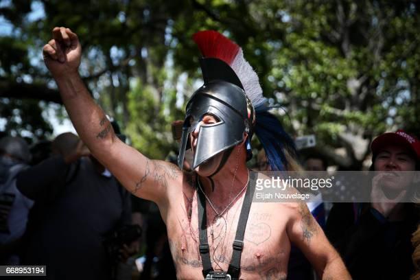 A Trump supporter dressed as a spartan holds up his middle finger to protesters at a 'Patriots Day' free speech rally on April 15 2017 in Berkeley...