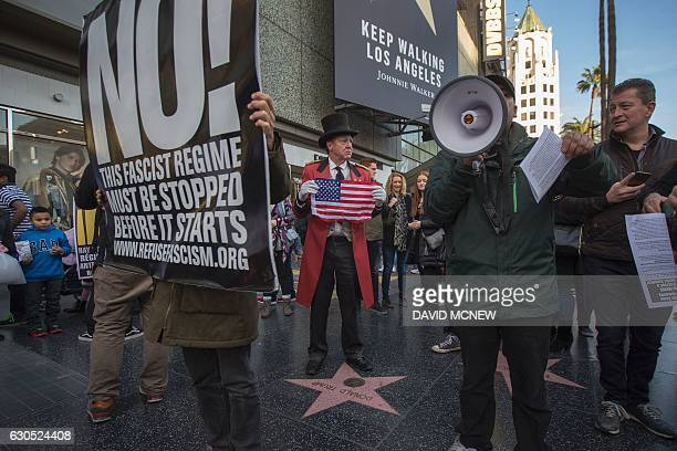 Trump supporter Gregg Donovan who calls himself the unofficial ambassador of Hollywood holds a flag over the Hollywood Walk of Fame star for Donald...