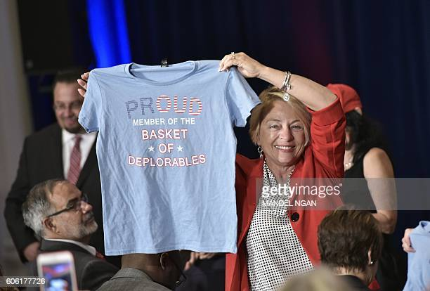 A Trump supporter holds a tshirt refering to a comment made by Democratic presidential nominee Hillary Clinton ahead of a campaign event by...