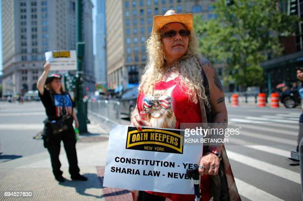 A Trump supporter holds up a sign during an antisharia law rally organized by ACT for America on June 10 2017 at Foley square in New York ACT for...