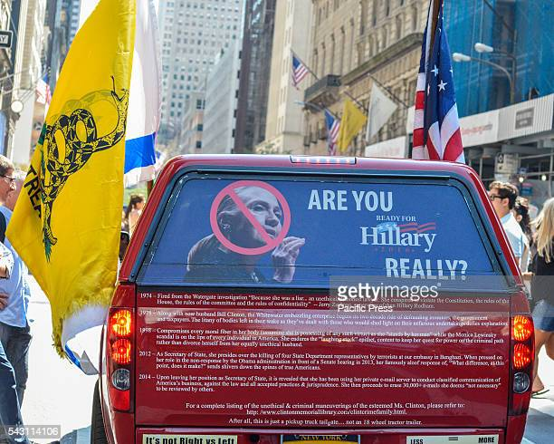 Trump supporter in a proTrump embellished vehicle affixed with Israeli US and Gadsden flags and an antiHillary Clinton message on its rear cruises on...
