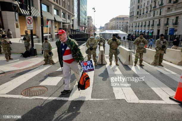 "Trump supporter, James Schenk protests, while carrying a ""Stop the Steal"" sign after Joe Biden is inaugurated as President of the United States along..."