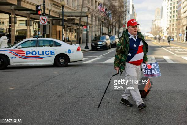 "Trump supporter, James Schenk protests, while carrying a ""Stop the Steal"" sign after Joe Biden's inauguration as President of the United States along..."