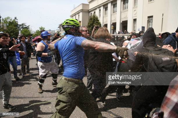 Trump supporter runs at protesters while being pepper sprayed at a 'Patriots Day' free speech rally on April 15 2017 in Berkeley California More than...